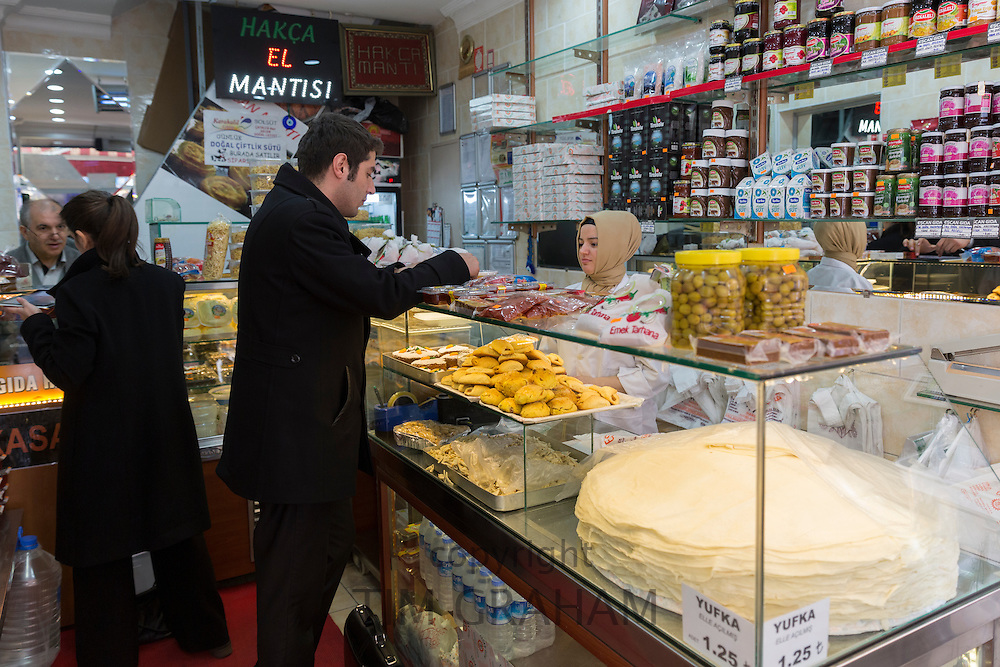 Turkish people shopping for food at food market in Kadikoy district on Asian side of Istanbul, East Turkey