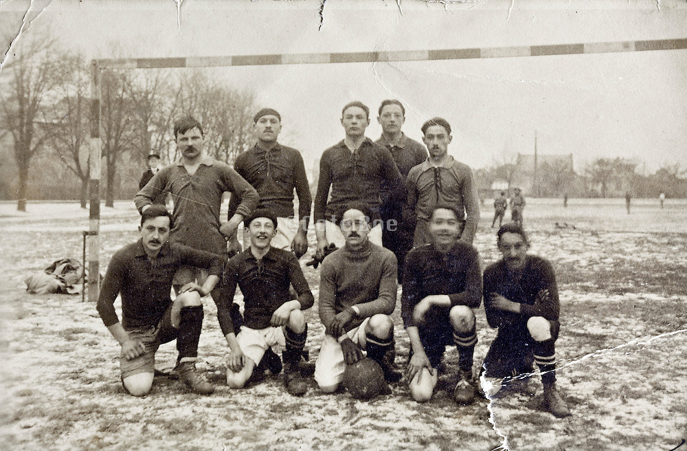 soccer team posing by goal early 1900s France