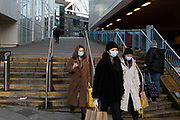 Young women out and about during the third national coronavirus lockdown in Birmingham city centre, which is empty apart from a few people on 12th January 2021 in Birmingham, United Kingdom. Following the recent surge in cases including the new variant of Covid-19, this nationwide lockdown, which is an effective Tier Five, came into operation yesterday, with all citizens to follow the message to stay at home, protect the NHS and save lives.