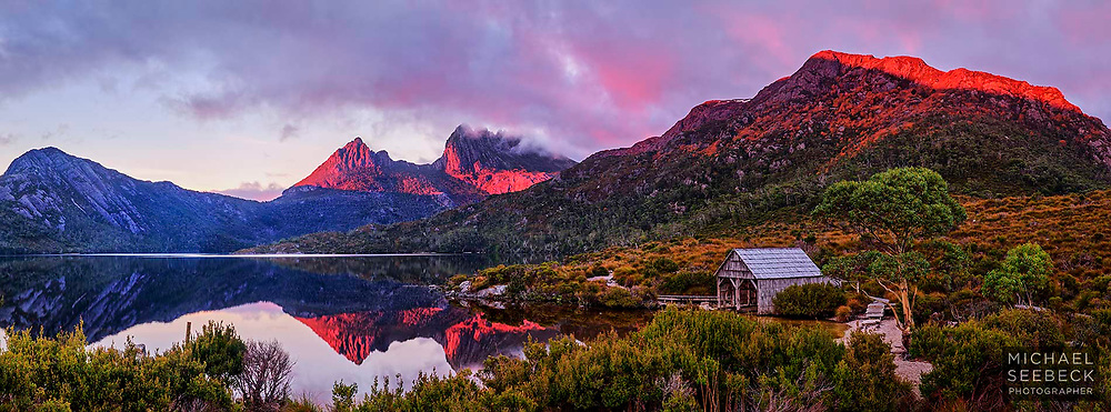 Sunrise over Dove Lake, with Cradle Mountain partly in cloud in the distance.<br /> <br /> Code: AADC0001<br /> <br /> Limited Edition of 125 Prints