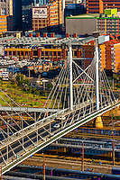 The Nelson Mandela Bridge connects the Braamfontein and Newtown areas of Johannesburg, South Africa. It has two pylons. It was constructed over 42 railway lines without disturbing railway traffic and is 284 metres long. It is illuminated at night by LED lighting featuring the color spectrum.