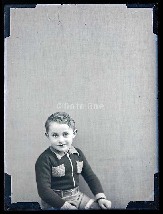 young boy posing for a studio portrait circa 1930s