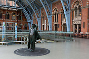 As the UK government urged that all Britons should avoid non-essential travel abroad in order to combat the Coronavirus pandemic in Britain, the statue of poet John Betjeman 2007 by Martin Jennings looks across on an unusually quiet concourse in St. Pancras rail station, the London terminus for Eurostar services to mainland Europe, on 17th March 2020, in London, England.