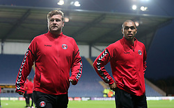 Charlton Athletic manager Karl Robinson (left) inspects the pitch prior to kick off at the Kassam Stadium