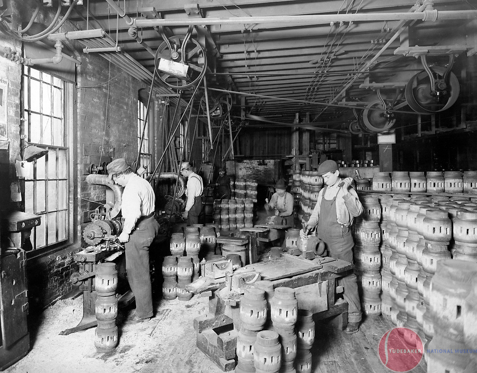 Studebaker workers finish wagon hubs in this c.1900 image.