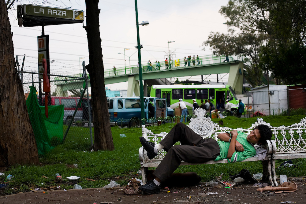 A homeless drug addict sleeps on a park bench in Mexico City.  Drugs use has been rising in Mexico City.  Low level dealers are now paid more often in drugs instead of money, and increased border security causes more drugs to stay in the country.  In the capital many homeless children and adults are addicted to sniffing paint thinner and also to crack.