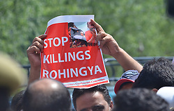 September 7, 2017 - India - A man attends a protest in Srinagar,Kashmir in solidarity with killing of Rohingya muslims in Myanmar by the state military and the Buddhist majority on September 07, 2017. (Credit Image: © Faisal Khan/Pacific Press via ZUMA Wire)