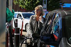 © Licensed to London News Pictures. 03/10/2021. London, UK. A 75 year old woman fills her car with diesel at Tesco petrol station in north London as the fuel crisis continues. The petrol station has run out of petrol and has limited supply of diesel, which will last until 2pm today. From tomorrow (4 October) military personnel, including 100 drivers, will start fuel deliveries.  Photo credit: Dinendra Haria/LNP