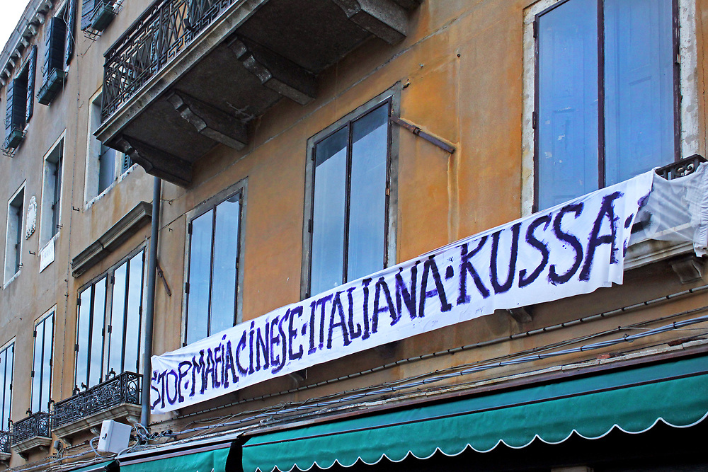 Banner in Venice, Italy saying 'Stop Chinese, Italian, Russian Mafia'