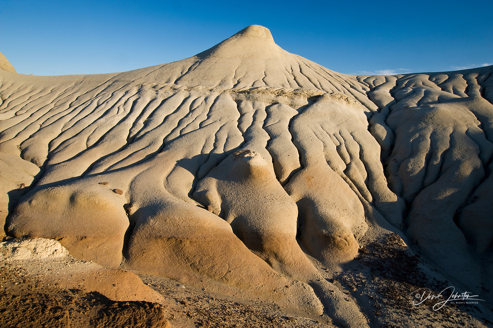Eroded mudstone hills in badlands environment, Dinosaur Provincial Park, Alberta, Canada
