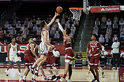 Southern California Trojans guard Drew Peterson (13) scores over Stanford Cardinal forward Jaiden Delaire (11) during an NCAA men's basketball game, Wednesday, March 3, 2021, in Los Angeles. USC defeated Stanford 79-42. (Jon Endow/Image of Sport)
