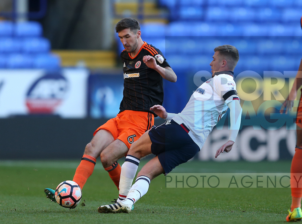 Chris Basham of Sheffield Utd tackles Josh Vela of Bolton Wanderers during the FA Cup Second round match at the Macron Stadium, Bolton. Picture date: December 4th, 2016. Pic Simon Bellis/Sportimage