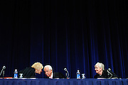 """Illinois Supreme Court Justice Anne M. Burke (left to right) jokingly """"confers"""" with Justice Charles E. Freeman and Justice Mary Jane Theis to support a motion to administer the Attorney's Oath to attendees of the court's 1st District Admission Ceremony for new attorneys at the Arie Crown Theater on Thursday, November 1st. © 2012 Brian J. Morowczynski ViaPhotos"""
