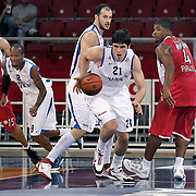 Anadolu Efes's Ersan ILYASOVA (C), Terence KINSEY (2ndL) and Olympiacos's Georgios PRINTEZIS (L), Kyle HINES (R) during their Two Nations Cup basketball match Anadolu Efes between Olympiacos at Abdi Ipekci Arena in Istanbul Turkey on Sunday 02 October 2011. Photo by TURKPIX