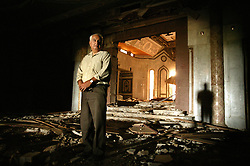 Mowfaq Al-Tai, an Iraqi architect, is seen inside the now partially destroyed Salam Palace in Baghdad, Iraq. According to Al-Tai, the Salam Palace is most representative of the design and architecture used in the hundreds of palaces built for Saddam Hussein. Al-Tai was one the the engineers involved in the construction and quality control of the Hussein palaces.