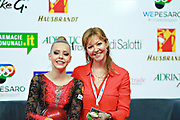 """Lyaysan Savitskaya, on right, is an honored Master of Sports coach of Russia in Rhythmic gymnastics. She born December 7, 1972 in Krasnodar,Russia. Polina Shmatko, on left, is a Russian individual rhythmic gymnast born on March 26, 2003 in Moscow, Russia. A double portrait on Kiss and Cry at """"Città di Pesaro"""" 2016 international tournament."""