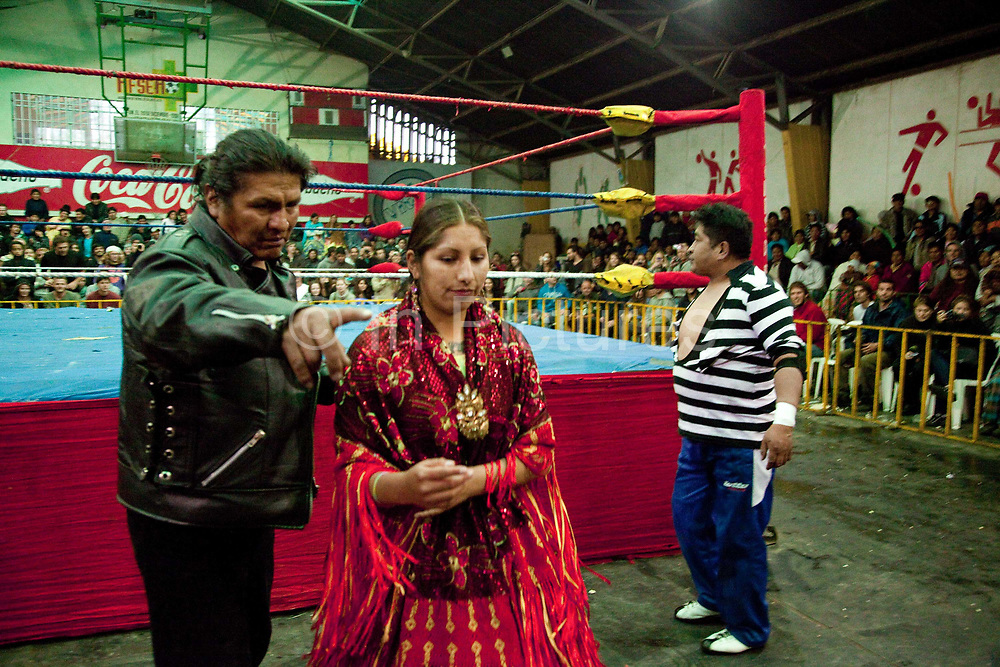 Alicia Flores female wrestler being sent off, out of ring. Lucha Libre wrestling origniated in Mexico, but is popular in other latin Amercian countries, including in La Paz / El Alto, Bolivia. Male and female fighters participate in the theatrical staged fights to an adoring crowd of locals and foreigners alike.