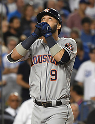 October 25, 2017 - Los Angeles, California, U.S. - Houston Astros' Marwin Gonzalez reacts after hitting a solo home run to tie the game against the Los Angeles Dodgers in the ninth inning of game two of a World Series baseball game at Dodger Stadium on Wednesday, Oct. 25, 2017 in Los Angeles. Houston Astros won 7-6 in 11 innings. (Photo by Keith Birmingham, Pasadena Star-News/SCNG) (Credit Image: © San Gabriel Valley Tribune via ZUMA Wire)