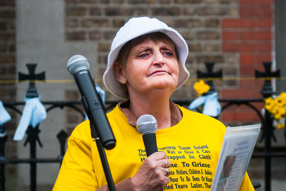 """Dublin, Ireland. 26th August, 2018. <br /> An Irish survivor speaks crying at the end of the silent march of the Stand4Truth protest at the sites of previous laundries, in Sean Macdermott Street Lower, during the Holy Mass of the second of the two-days of the visit of Pope Francis in Dublin, Ireland.<br /> Pope Francis has made a two-day visit to the Republic of Ireland by celebrating a Mass at Dublin's Phoenix Park. The Argentine Pope asked forgiveness for the """"abuses in Ireland, abuses of power, conscience and sexual abuses"""" perpetrated by Church leaders. It was the first papal visit to Ireland for 39 years. During his activities many activists, victims and survivors have made protests and a silent march Garden of Remembrance towards the last Magdalene Laundry to close in Ireland.<br />  © Simone Padovani"""