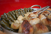 Close-up of Sarma (also warak enab or Dolma) vine leaves wrapped around a filling of rice and minced meat