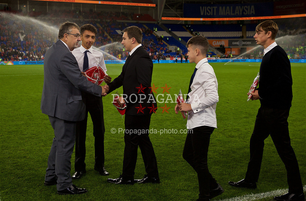 CARDIFF, WALES - Thursday, September 6, 2018: Wales disability squad players receive their caps from Football Association of Wales President Kieran O'Connor during the UEFA Nations League Group Stage League B Group 4 match between Wales and Republic of Ireland at the Cardiff City Stadium. (Pic by David Rawcliffe/Propaganda)