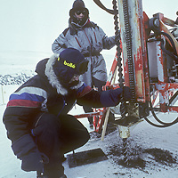 Working in sub-zero temperatures, geologists prepare blasting holes in search of minerals on Spitsbergen Island, half way between Norway and the North Pole.
