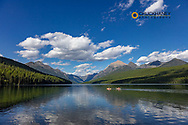 Sea kayaking on Bowman Lake in Glacier National Park, Montana, USA