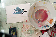artist studio still life with paint mix and test