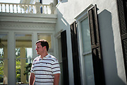 """EUFALA, AL – AUGUST 17, 2017: Brad Griffin, 36 stands in front of the historic Shorter Mansion on Eufala Avenue. Griffin, 36, is the Communications Director for the League of the South, a neo-Confederate group that advocates for a second Southern secession and a society dominated by """"European Americans."""""""