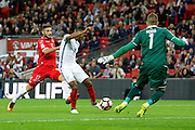 England Midfielder Theo Walcott has a shot on goal during the FIFA World Cup Qualifier match between England and Malta at Wembley Stadium, London, England on 8 October 2016. Photo by Andy Walter.
