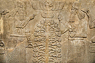 Assyrian relief sculpture panel  of King  Ashurnasirpal II dressed in Ritual robes, he is depicted twice on either side of the central sacred tree of life.  Above the tree of life is a winged disc with possible the sun god Shamash in it.  From Nimrud, Iraq,  865-860 B.C North West Palace. Room B, panel 23.  British Museum Assyrian  Archaeological exhibit no WA 124531. .<br /> <br /> If you prefer to buy from our ALAMY PHOTO LIBRARY  Collection visit : https://www.alamy.com/portfolio/paul-williams-funkystock/ancient-assyria-antiquities.html  Refine search by adding background colour, place, subject, museum etc into the LOWER SEARCH WITHIN GALLERY box to <br /> <br /> Visit our ANCIENT ASSYRIAN PHOTO COLLECTIONS for more photos to download or buy as wall art prints https://funkystock.photoshelter.com/gallery-collection/Ancient-Assyrian-Art-Artefacts-Antiquities-Historic-Sites-Pictures-Images-of/C0000cjRqQyJjLag