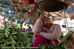 Visit to a fegetable market in the main square of Darechok while we regrouped on day-9 of our Himalayan Heroes adventure riding from Pokhara to Nuwakot, Nepal. Wednesday, November 14, 2018. Photography ©2018 Michael Lichter.