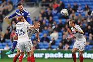 Cardiff City's Sean Morrison (blue) rises highest to beat Wigan's Shaun MacDonald (16) and Dan Burn for a header. EFL Skybet championship match, Cardiff city v Wigan Athletic at the Cardiff city stadium in Cardiff, South Wales on Saturday 29th October 2016.<br /> pic by Carl Robertson, Andrew Orchard sports photography.