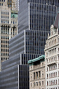 Modern architecture and the 1903 Gothic Woolworth building on the left, in Manhattan, New York City.