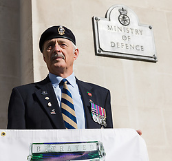 October 5, 2018 - London, London, UK - London, UK. Members of the pressure group, Justice for Northern Ireland (NI) Veterans stage a picket protest outside the Ministry of Defence in Whitehall as part of a national day of protest to demonstrate against what they claim is a witch-hunt to prosecute former service personnel who served during the conflict in northern Ireland. (Credit Image: © Vickie Flores/London News Pictures via ZUMA Wire)
