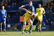 AFC Wimbledon forward James Hanson (18) battles for the ball during the EFL Sky Bet League 1 match between Oxford United and AFC Wimbledon at the Kassam Stadium, Oxford, England on 13 April 2019.
