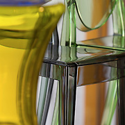 Tight photograph of colorful, translucent, modern Kartell chairs and tables