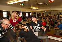 Badger Drewes officiates a match between Gabrielle Vigeant and Angel Veley during the Arm Wrestling Tournament to benefit the Fallen 7 at the Laconia VFW on Saturday.  (Karen Bobotas/for the Laconia Daily Sun)