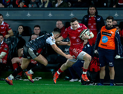 Steff Evans of Scarlets under pressure from Owen Watkin of Ospreys<br /> <br /> Photographer Simon King/Replay Images<br /> <br /> Guinness PRO14 Round 11 - Ospreys v Scarlets - Saturday 22nd December 2018 - Liberty Stadium - Swansea<br /> <br /> World Copyright © Replay Images . All rights reserved. info@replayimages.co.uk - http://replayimages.co.uk