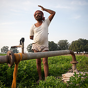 Harnek Singh, a farmer at village Khunimajra, some 25km form Chandigarh, in his field next to the submerged water pump. The pump's engine is 270ft underground while the ground water level is 650ft deep. He complaines tht the state government does not supply enough electricity for him to water his fields. Electricity is suplied for only  three hours every day, between 8-11am. Farmers in punjab are facing problems of depleting levels of underground water levels that in some places is as deep as 700ft.