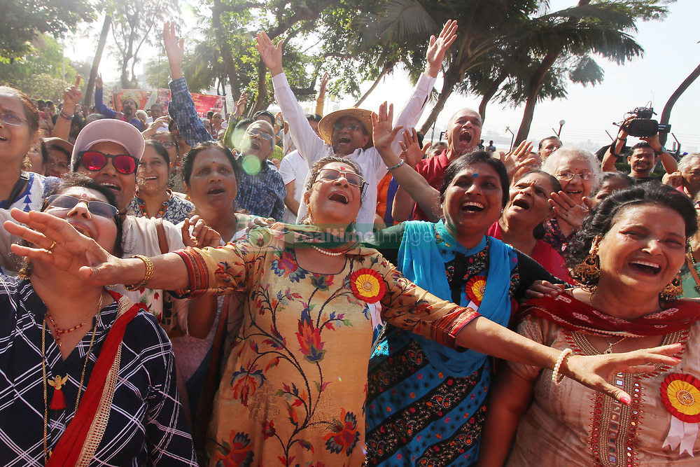 """May 5, 2019 - Mumbai, India - Members of a laughter club practice laughter on the occasion of 'World Laughing Day' in Mumbai, India on 05 May 2019. """"World Laughter Day"""" is celebrated on the first Sunday of May every year. (Credit Image: © Himanshu Bhatt/NurPhoto via ZUMA Press)"""
