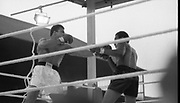 Ali vs Lewis Fight, Croke Park,Dublin.<br /> 1972.<br /> 19.07.1972.<br /> 07.19.1972.<br /> 19th July 1972.<br /> As part of his built up for a World Championship attempt against the current champion, 'Smokin' Joe Frazier,Muhammad Ali fought Al 'Blue' Lewis at Croke Park,Dublin,Ireland. Muhammad Ali won the fight with a TKO when the fight was stopped in the eleventh round.<br /> <br /> Picture of Lewis as he parries the Ali left jab.