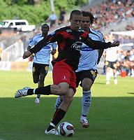 Fotball Tippeligaen 10.06.07 Rosenborg - Fredrikstad <br /> Patrik Gerrbrand, Fredrikstad og Daniel Bråten RBK<br /> Foto: Carl-Erik Eriksson, Digitalsport