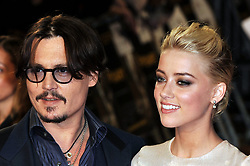 May 26, 2016 - File - AMBER HEARD has filed for divorce from JOHNNY DEPP after just 15 months of marriage amid claims his family hated her. The actress, 30, submitted court documents on Monday citing irreconcilable differences and seeking spousal support, triggering a battle over the star's 00 million fortune. Depp, 52, is father to 16-year-old Lily-Rose Depp and 14-year-old Jack Depp. His mom, Betty Sue Palmer, died just three days before Heard signed a petition for divorce Monday. Pictured: Nov. 3, 2011 - London, New York, Great Britain -   . . . . .   . . . . . US SALES ONLY . . . .  .November 3 2011, London Johnny Depp and Amber Heard at the European premiere of 'The Rum Diary' at the Odeon Kensington at on November 3, 2011 in London, England. (Credit Image: © Sharkpixs/ZUMAPRESS.com)