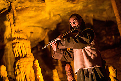 Musician performs during the Living Nativity Scenes inside Postojna Cave, on December 21, 2017 in Postojna, Slovenia. Living Nativity Scene is staged along a 5 km long path through the world-famous Postojna Cave in Slovenia with some 200 people performing and working. Photo by Vid Ponikvar / Sportida