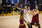 Golden State Warriors guard Stephen Curry (30) lays the ball in the basket against the Cleveland Cavaliers at Oracle Arena in Oakland, Calif., on January 16, 2017. (Stan Olszewski/Special to S.F. Examiner)