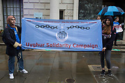Activists from Uyghur Solidarity Campaign UK protest opposite the Chinese embassy in support of the Uyghur people's struggle for freedom on 5th August 2021 in London, United Kingdom. Activists highlighted the Chinese governments persecution and forced assimilation of Uyghurs, Kazakhs and other indigenous people in East Turkestan and Xinjiang and called for them to have the right to determine their own futures through a democratic process.