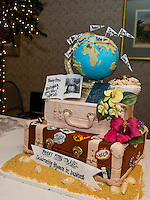 Penny Pitou Travel celebrates 40 years in business with a special cake made my White Mountain Cupcake during their Travel Trade Show at the Margate Saturday afternoon.   (Karen Bobotas/for the Laconia Daily Sun)