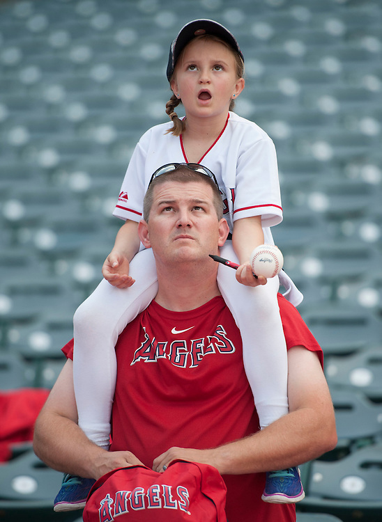 Angel fans watch batting practice before the Angels 4-2 loss to the Houston Astros Saturday at Angel Stadium.<br /> <br /> ///ADDITIONAL INFO:   <br /> <br /> angels.0529.kjs  ---  Photo by KEVIN SULLIVAN / Orange County Register  -- 5/28/16<br /> <br /> The Los Angeles Angels take on the Houston Astros Saturday at Angel Stadium.