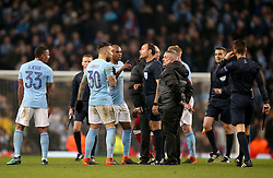 Manchester City's Fernandinho and Nicolas Otamendi remonstrate with Referee Antonio Miguel Mateu Lahoz at half time